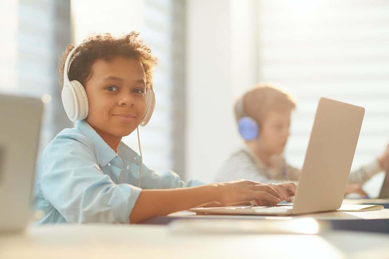 Boy In Headphones At School