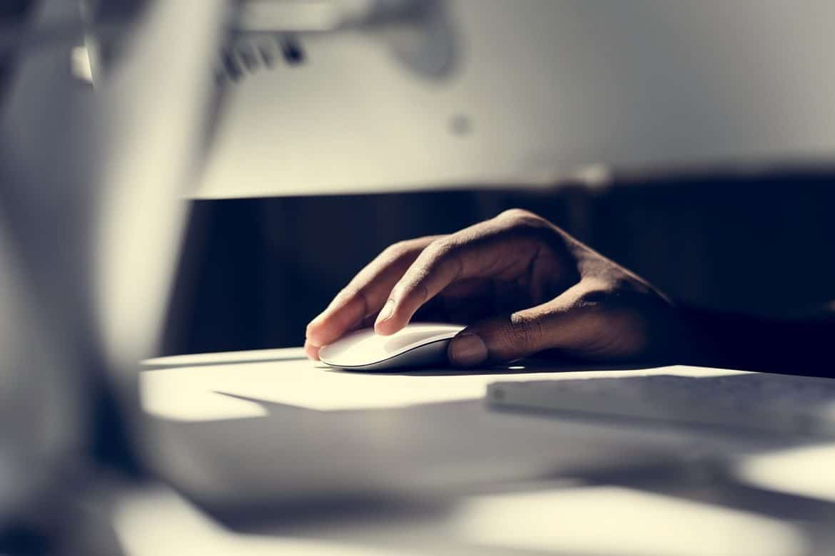 Close up of hand using a computer