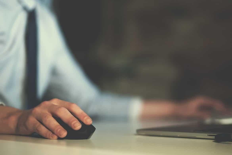 Hand using computer mouse closeup